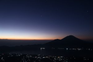Stars and sunrise on Batur volcano