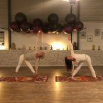 Two woman practicing the triangle pose in yoga