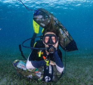 a diver taking a break after a Dive Against Debris