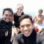 Scuba divers smiling after a dive