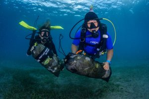 Scuba Divers with Trash Bags underwater